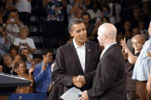 Nathan Wilkes shakes hands with President OBAMA